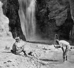 E.C. LaRue measuring Deer Creek flow